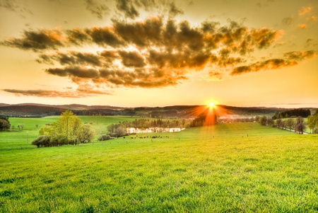 beautiful meadow during sunset with dramatic sky Stock Photo - 8962774