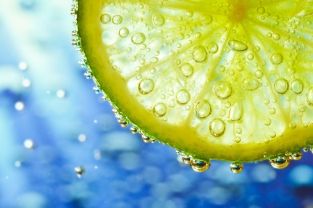 slice of lime with bubbles Stock Photo - 8962673