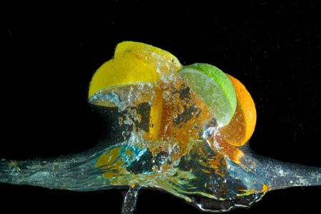 fruit splashing in the water photo