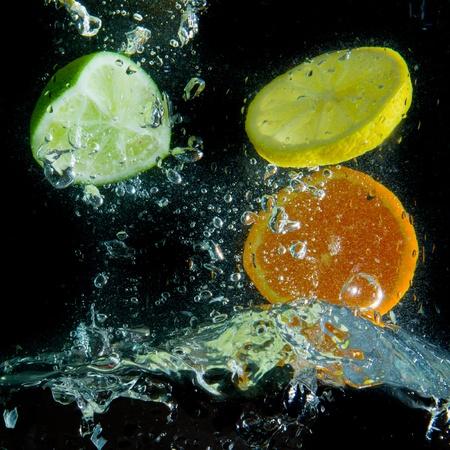 fruit splashing in the water photo