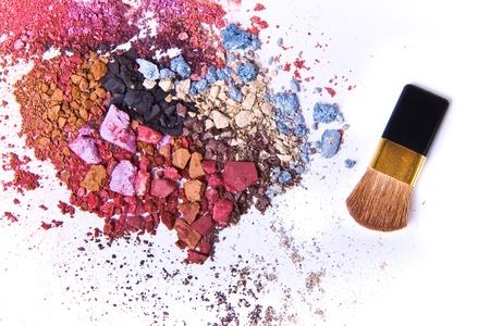 crushed: eyeshadow mix with brush on white background Stock Photo