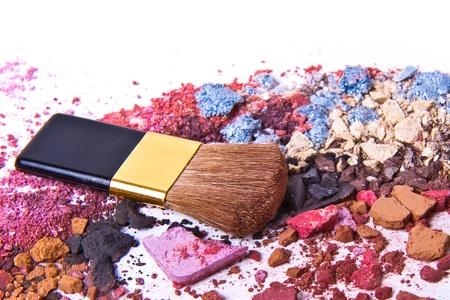 eyeshadow mix with brush on white background photo