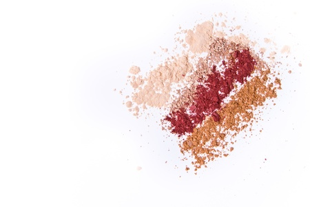 makeup powder in three colors on white background photo