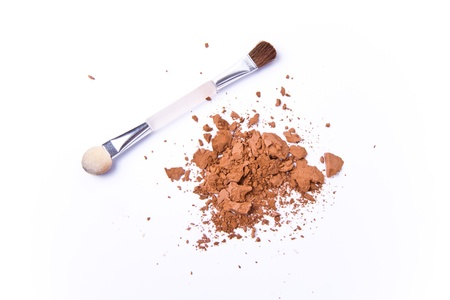 crushed eyeshadow isolated on white background photo