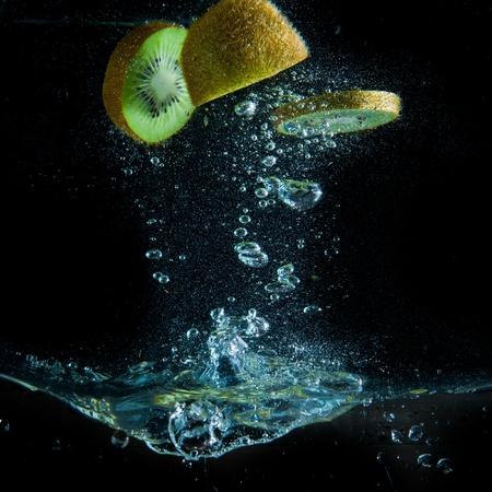 kiwi fruit splashing in the water Stock Photo - 9121738