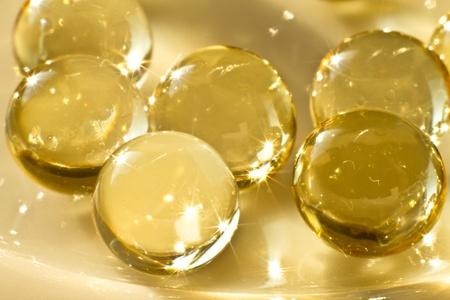 close up of vitamin oil capsules photo