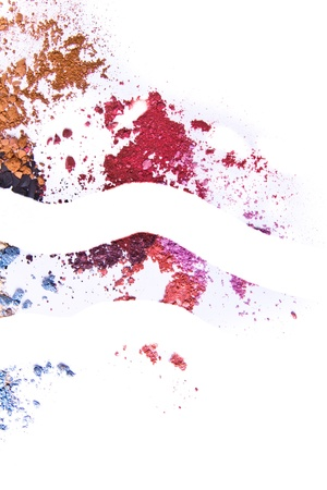 crushed eyeshadow on white background photo