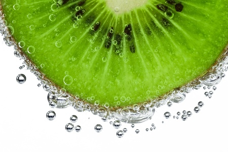 refreshment: sliced kiwi covered with bubbles Stock Photo