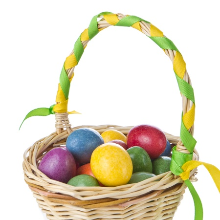 easter nest: colorful easter eggs in basket isolated Stock Photo