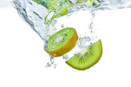 soda splash: sliced kiwi fruit splashing isolated on white background Stock Photo