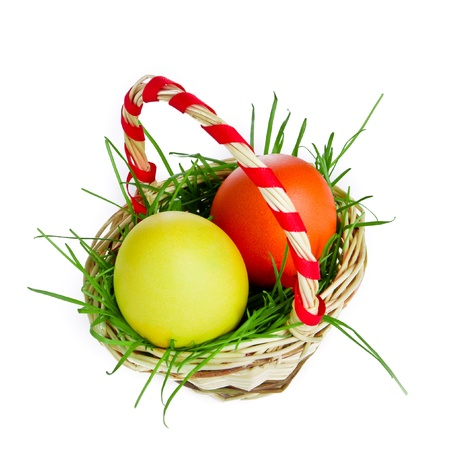 easter eggs in basket isolated photo