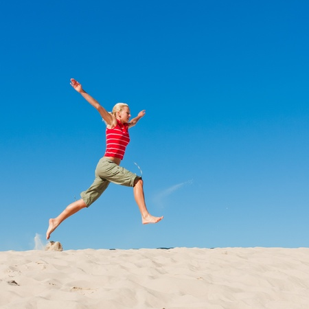 beautiful female exercising on the sand dunes Stock Photo - 12441554