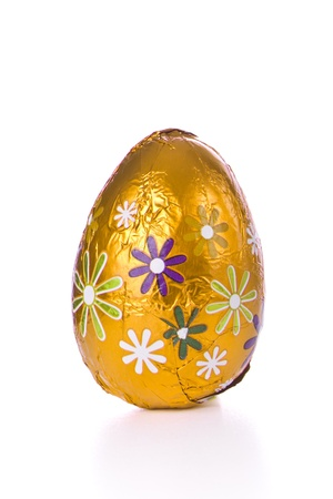 gold eggs: wrapped chocolated easter egg isolated