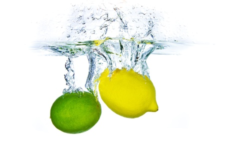 lime green: lime and lemon splashing water isolated on white background