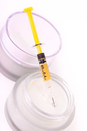 rejuvenating botox cream with syringe isolated photo