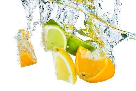 citrus fruit splashing isolated on white background photo