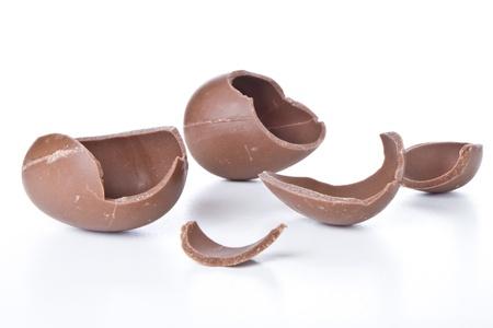 cracked chocolate egg isolated on white Stock Photo - 9464696