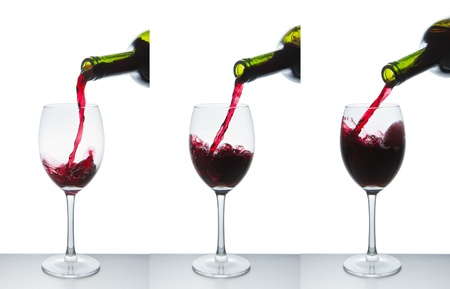 red wine pouring into wine glass isolated Stock Photo - 9527256
