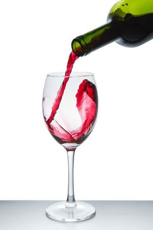 red wine pouring into wine glass isolated Stock Photo - 9527254