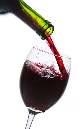 red wine pouring into wine glass isolated Stock Photo - 9527291