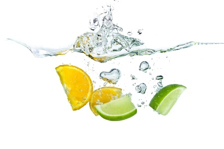 citrus fruit splashing isolated on white background photo