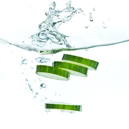 sliced cucumber splashing water isolated on white background Stock Photo - 9576563