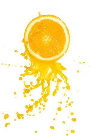 orange juice splash isolated on white background Stock Photo - 9576695