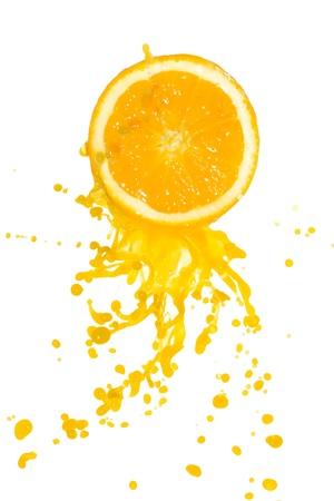 orange cut: orange juice splash isolated on white background
