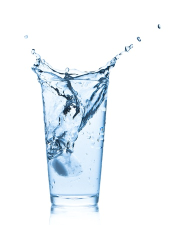 water splashing from glass isolated on white background photo