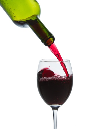 red wine pouring into wine glass isolated Stock Photo - 9576449