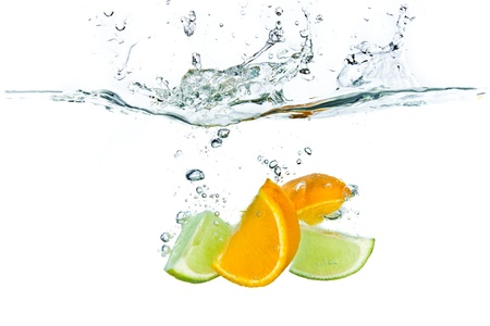 soda splash: citrus fruit splashing isolated on white background Stock Photo