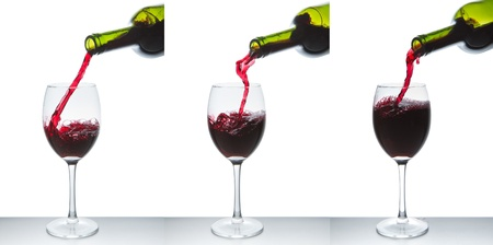 red wine pouring into wine glass isolated Stock Photo - 9651585
