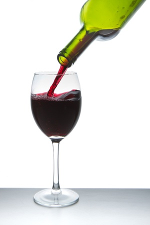 red wine pouring into wine glass isolated Stock Photo - 9651581