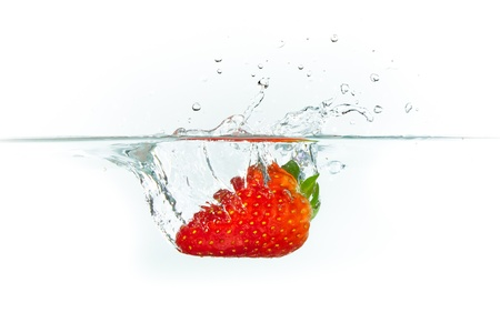 strawberry splash: fresh strawberry dropped into water with splash on white backgrounds