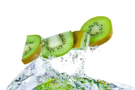 sliced kiwi fruit splashing isolated on white background photo