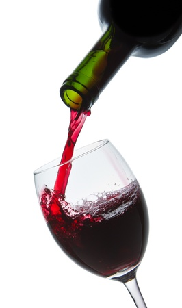 red wine pouring into wine glass isolated photo