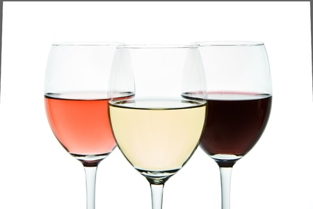 three glasses with white, rose and red wine Stock Photo - 9824603