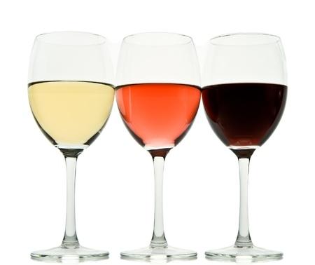 wine pouring: tre bicchieri con bianco, rosa e vino rosso Archivio Fotografico
