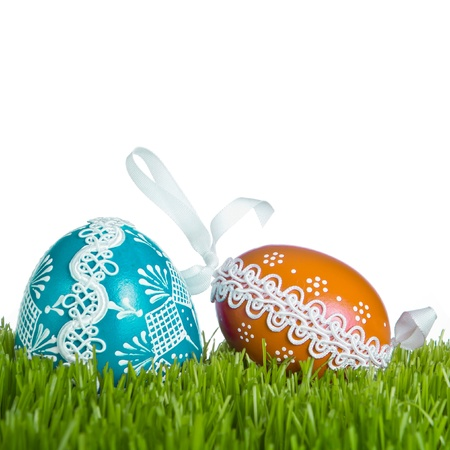 decorated easter eggs in the grass photo