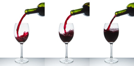 red wine pouring into wine glass isolated Stock Photo - 10024785