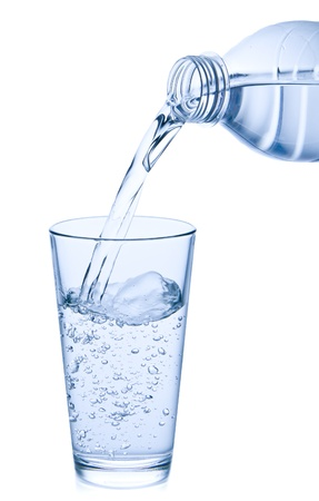 water drink: water pouring into glass on white background