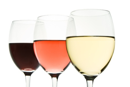 three glasses with white, rose and red wine Stock Photo - 10024787