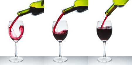 winetasting: red wine pouring into wine glass isolated Stock Photo