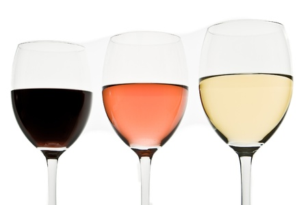 three glasses with white, rose and red wine Stock Photo - 10183315