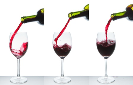 red wine pouring into wine glass isolated Stock Photo - 10205367