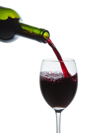red wine pouring into wine glass isolated Stock Photo - 10205340