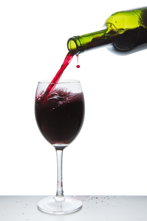 red wine pouring into wine glass isolated Stock Photo - 10205351