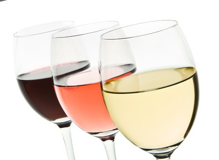 three glasses with white, rose and red wine Stock Photo - 10205363