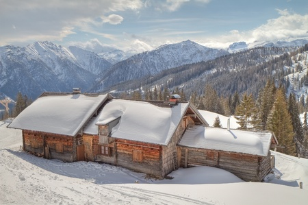 wooden cabin in winter alps photo