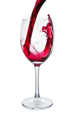 burgundy drink glass: red wine pouring into wine glass isolated Stock Photo